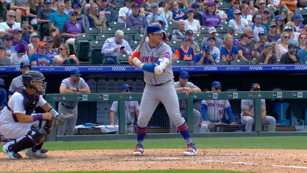 Mets score four in the ninth and defeat Rockies, 7-4