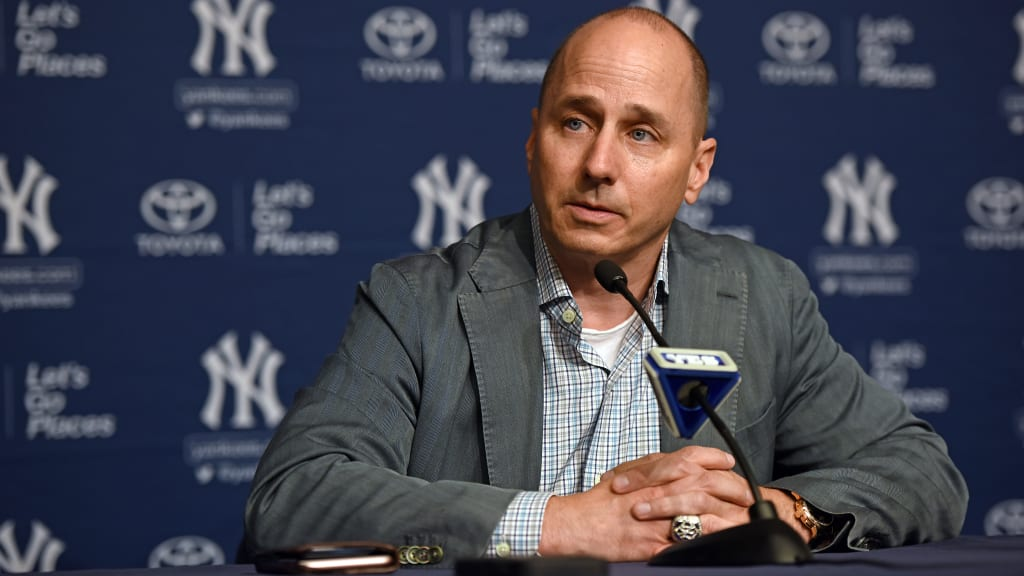 Image result for brian cashman at work
