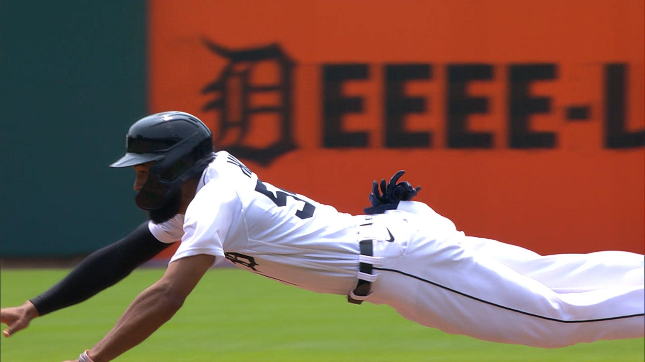 Derek Hill steals second base