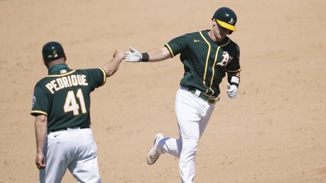 Murphy flexes power in win over Halos