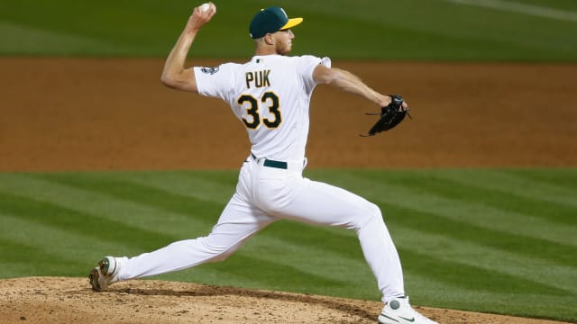 A's place Puk on IL with left biceps strain