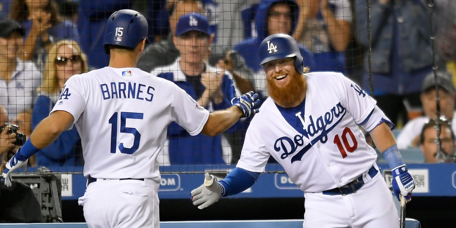 Dodgers pile 11 on Mets to keep pace in West