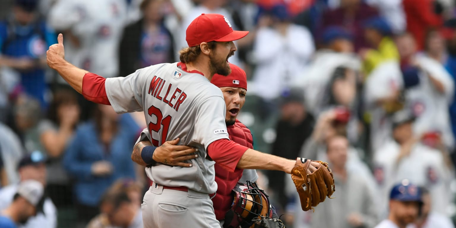Cards rally to clinch playoff berth, sweep Cubs